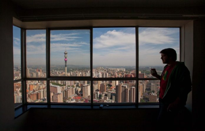 Room with a view: Nickolaus Bauer in his 51st floor apartment in Ponte City.