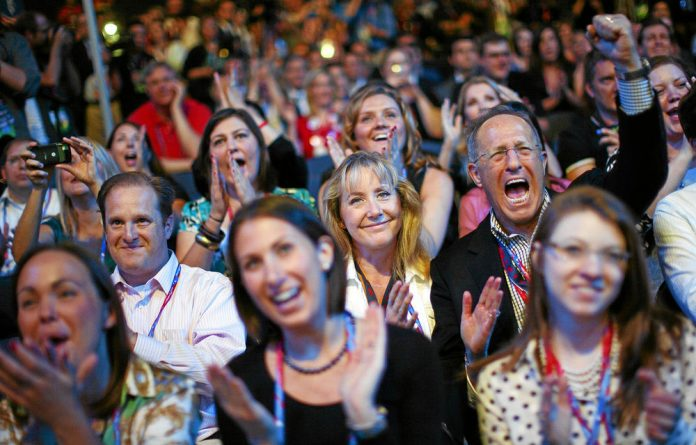 Delegates cheer for presidential candidate Mitt Romney during the Republican National Convention.