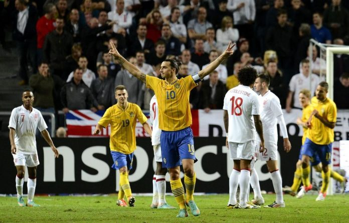 Sweden's team captain Zlatan Ibrahimovic celebrates after scoring his third goal during Sweden's 4-0 win over England in a friendly match.