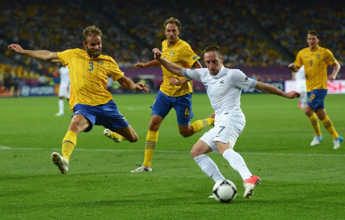 Franck Ribery of France is challenged by Olof Mellberg of Sweden during the Uefa Euro 2012 group D match between Sweden and France.
