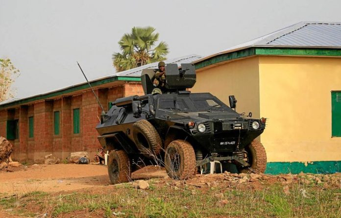 Secure learning: A Nigerian army vehicle guards LEA primary school in Angwan Gata in Kaduna state.