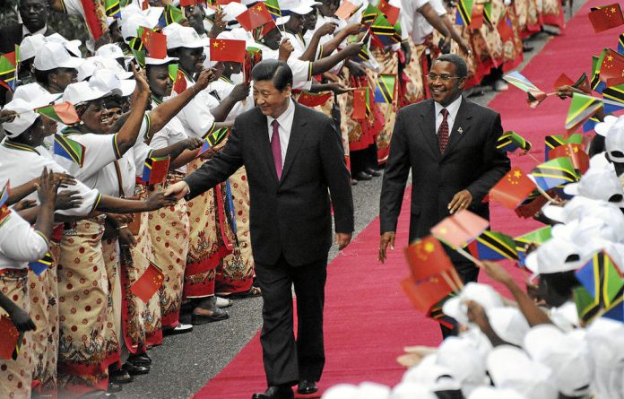 Firm grip: Presidents Xi Jinping and Jakaya Kikwete have signed deals worth $6-billion.