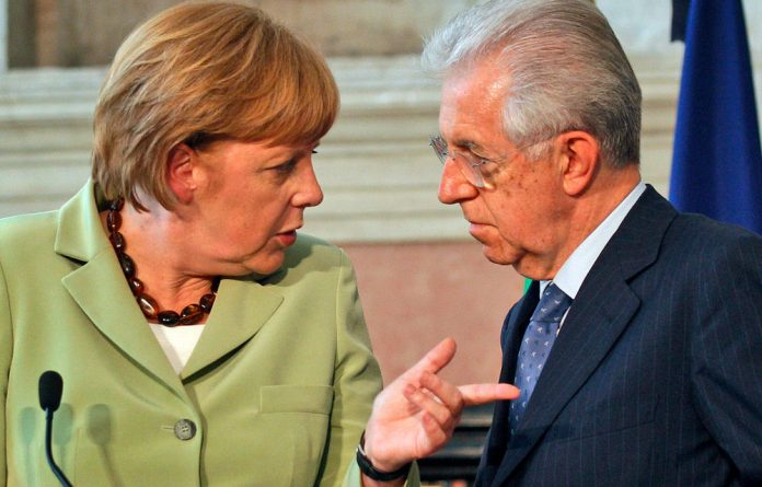 German Chancellor Angela Merkel confers with Italian Premier Mario Monti during a press conference in Rome on June 22.