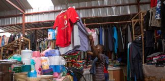 A man looks at clothing items in the Nyabugogo Market in Kigali.