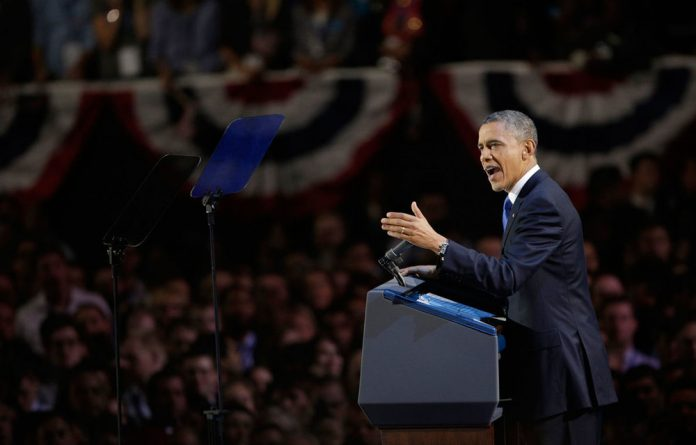 US President Barack Obama has created history again after projections showed he beat Republican contender Mitt Romney for re-election.