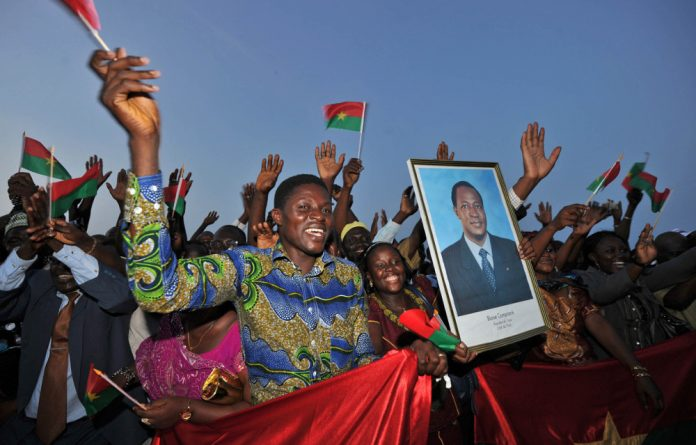Blaise Compaore's former chief-of-staff declared announced a night-time curfew across the west African state