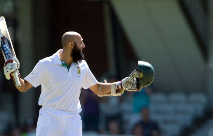 South Africa's Hashim Amla looks towards the dressing room after he reaches 200 during the fourth day of the first cricket test match against England at the Oval cricket ground