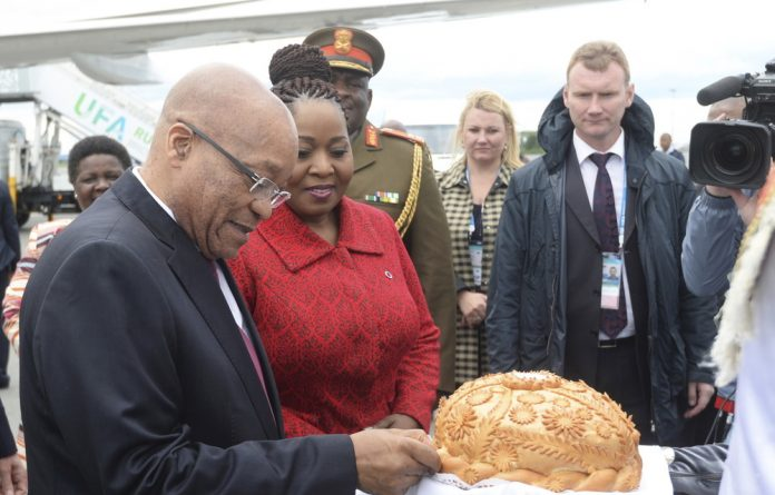 President Jacob Zuma takes part in a traditional bread and salt ceremony upon his arrival before attending the Brics summit in Ufa