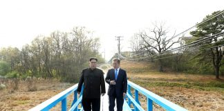 South Korean President Moon Jae-in and North Korean leader Kim Jong-un walk together at the truce village of Panmunjom inside the demilitarised zone separating the two Koreas