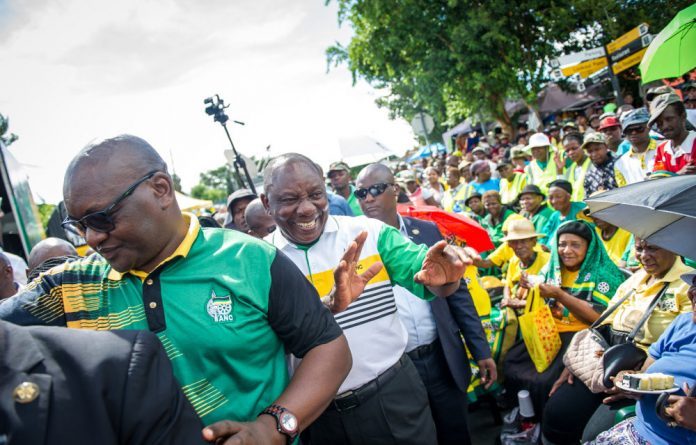 Deputy President Cyril Ramaphosa greets ANC supporters at the organisation's pre-January 8 statement party in Soweto.