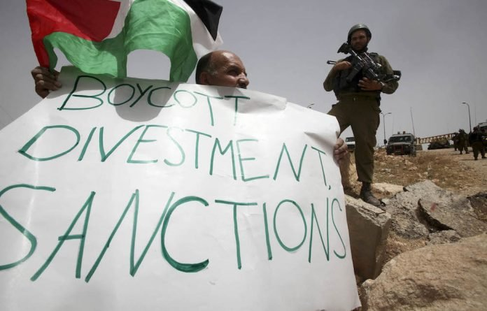 A Palestinian protests near the Jewish settlement of Bar Ayin. The growing influence of the Boycott