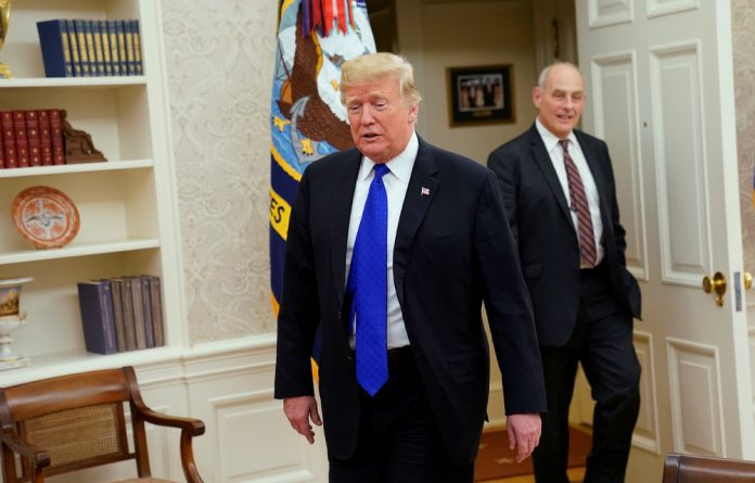 US President Donald Trump arrives with White House Chief of Staff John Kelly.