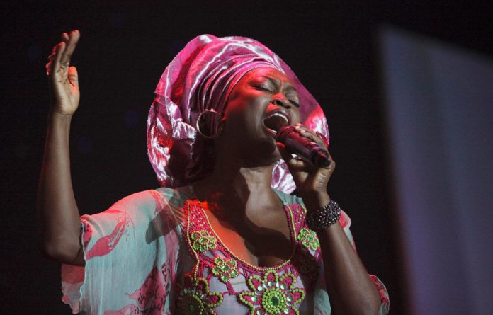 Nigerian artist Yinka Davies sports a demure gele while performing during the annual Africa movie academy awards in Lagos