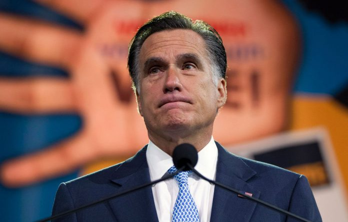 Mitt Romney has hastened to assure Hispanic voters that he's 'not going to round up people around the country and deport them'.