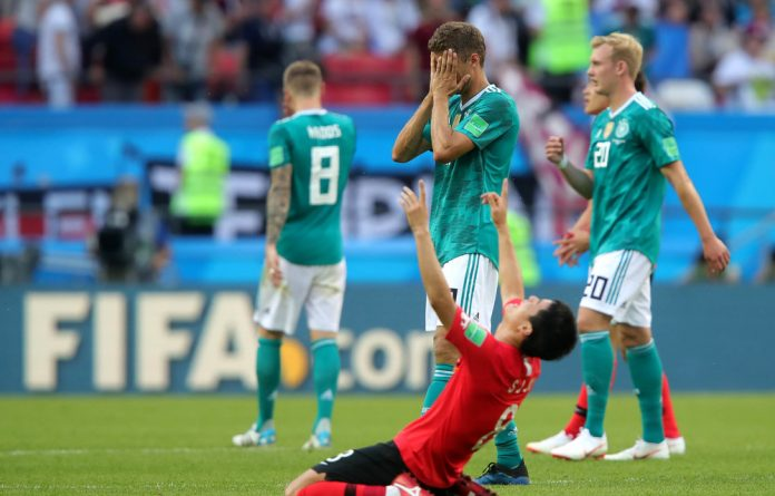 Thomas Mueller despairs after Germany's defeat by Korea Republic.