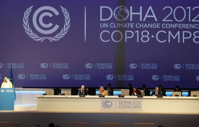 COP18 president Abdullah bin Hamad Al-Attiyah delivers a speech during the opening ceremony of the 18th United Nations Convention on Climate Change.