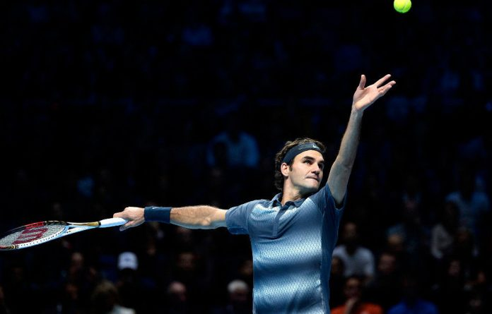 Roger Federer serves to Rafael Nadal during the semi-final of the ATP World Tour Finals at the O2 Arena in London on November 10 2013.