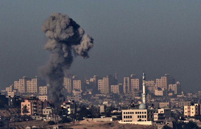 Smoke billows from a spot targeted by the Israeli military inside the Gaza Strip.