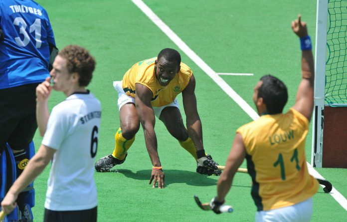 Owen Mvimbi of South Africa celebrates a goal against Austria.