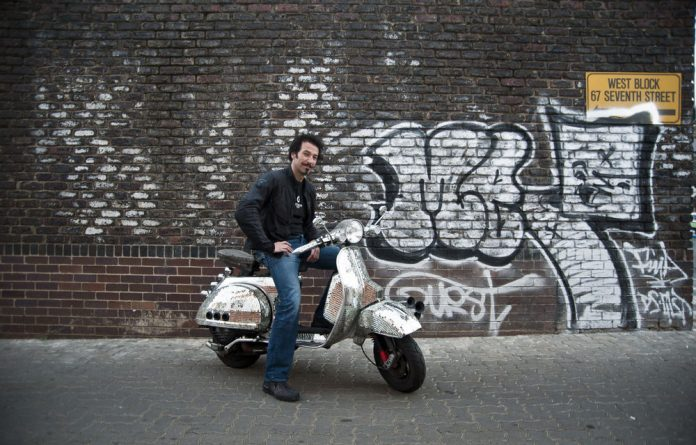 All that glitters: Artist Yiull Damaso customised his Vespa by covering it with 43kg of mirror fragments.