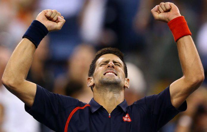Novak Djokovic of Serbia celebrates match point during his men's singles quarterfinal match against Juan Martin Del Potro.