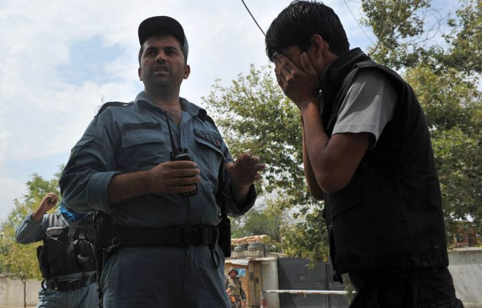 An Afghan man cries at the site of a suicide attack in the city's diplomatic quarters