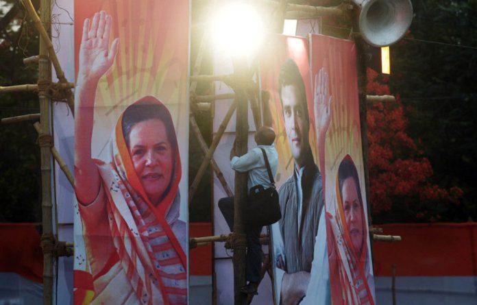 Goodbye Gandhi: Indian Congress party posters of president Sonia Gandhi and vice-president Rahul Gandhi.