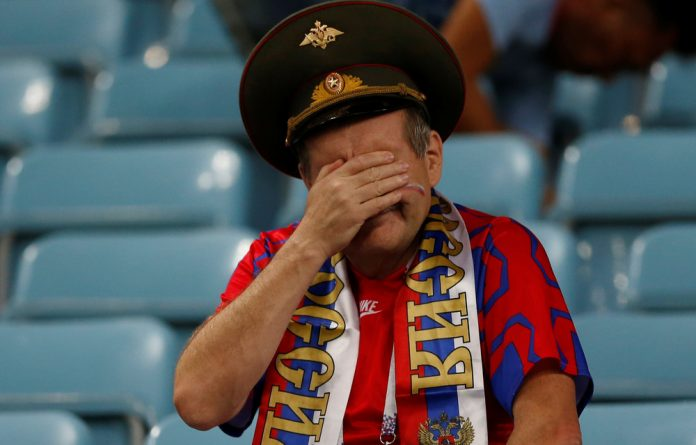 Russia fan looks dejected at the end of the match