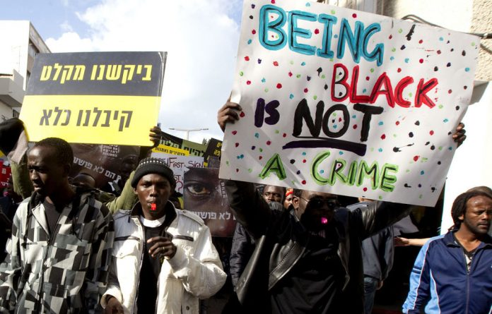 In this file photo African immigrants take part in an Annual Human Rights march in Tel Aviv to mark International Human Rights Day.