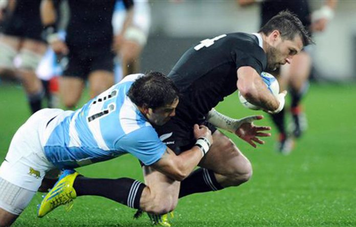 New Zealand's Cory Jane is tackled by Argentina's Horado Aguila during the Investec International Championship rugby match at Westpac Stadium in Wellington