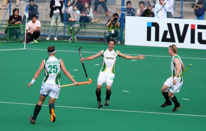 Thornton Mcdade of South Africa celebrates with his team-mates after scoring a goal.
