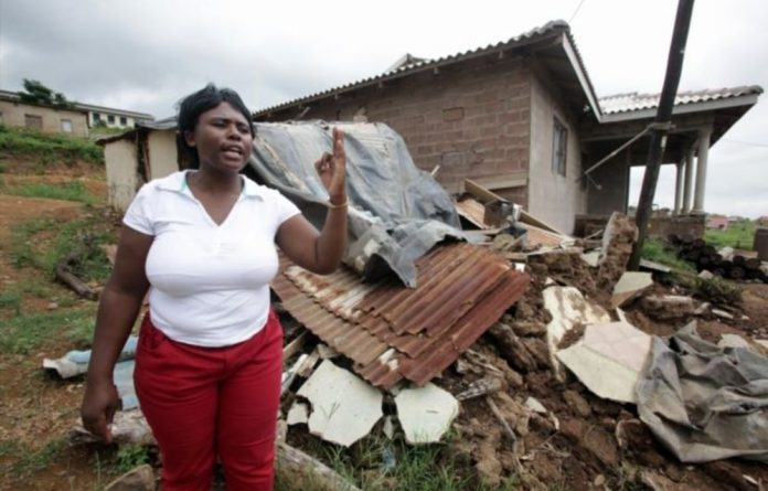 Hlengiwe Msweli stands in front of her house on January 28 2013 in Durban