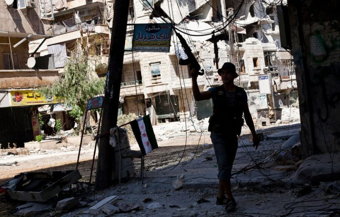 Syrian troops have bombarded a central area of Aleppo after a day of fierce clashes with rebels who tried to take the regime-controlled district.
