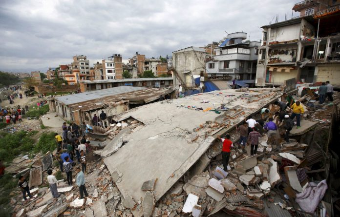Houses were reduced to rubble in Kathmandu following the 7.9-magnitude earthquake.