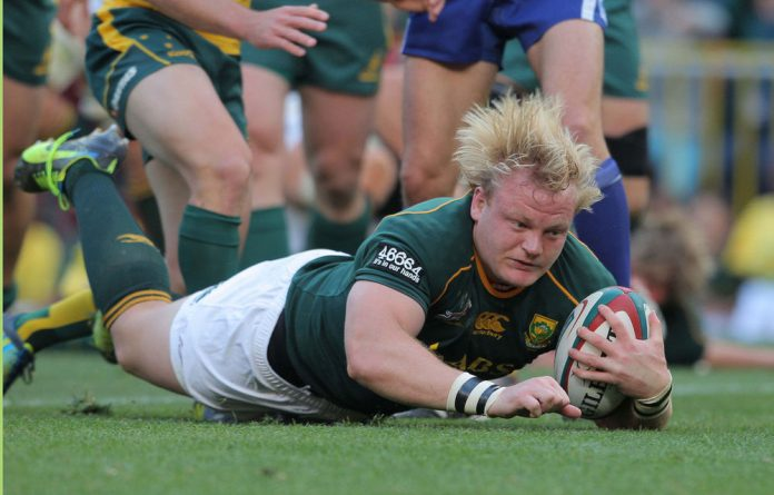 Adriaan Strauss of the Springboks scores the opening try against Australia during the Castle Rugby Championship match at Newlands Stadium on Saturday.