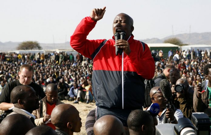 The strikers said they would go with Malema to the local police station to lay murder charges against police who shot dead 34 of their colleagues last Thursday.