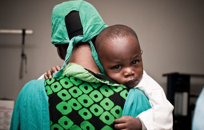 Kehinde Oluwafemi with his mother before eye surgery.