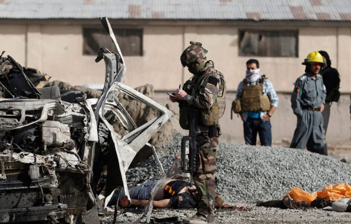 A suicide bomber blew herself up alongside a minivan carrying foreigners on a major highway leading to the international airport in the Afghan capital.