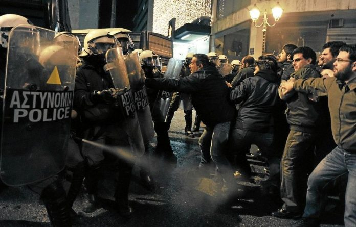 Greek riot police clashed with protesters in Athens on January 8 during ceremonies marking Greece's official takover of the six-month European Union presidency.