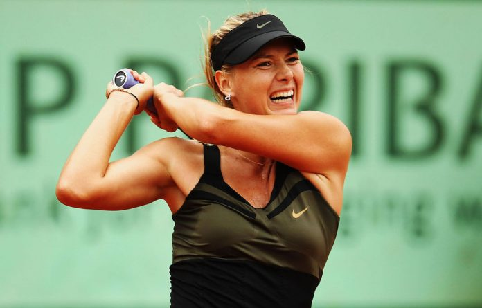 Maria Sharapova of Russia plays a backhand in her women's singles second round match against Ayumi Morita of Japan during day 6 of the French Open.