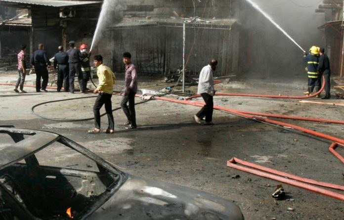 A series of apparently coordinated bombings across Iraq on the eve of the Islamic new year killed 15 people and wounded dozens.