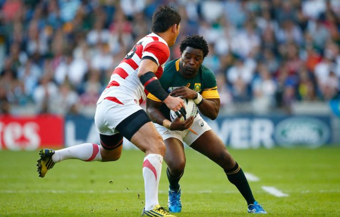 Limited opportunities: Siya Kolisi in action against Japan.
