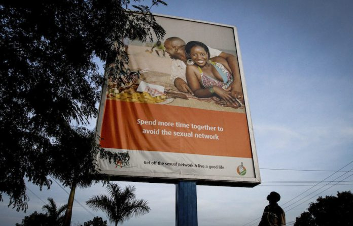 Two to tango: A billboard in Uganda promotes fidelity as a way to curb the spread of HIV. The author of this column believes that abstinence campaign should not target women alone.