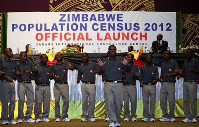 A music group performs during the launch of the country's Population Census which begins Aug. 17 in Harare. Zimbabwe last conducted its census in 2002.