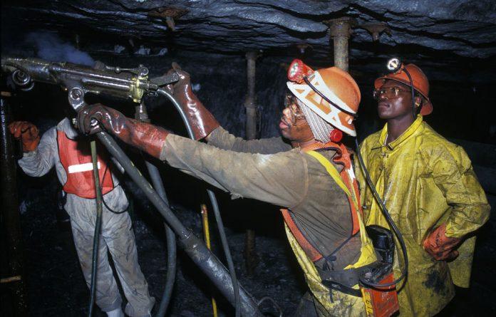 Royal Bafokeng Platinum could cut jobs as its first-half profits dropped by 60%.
