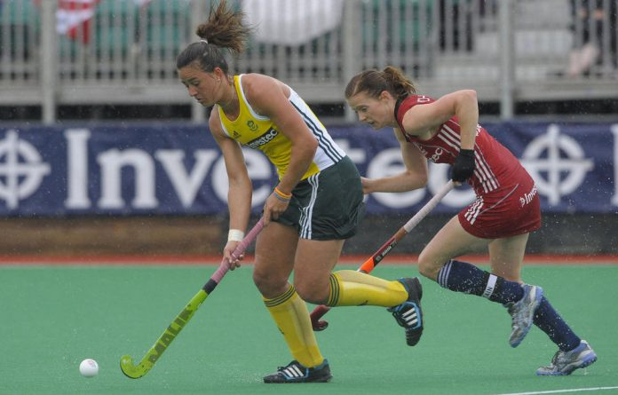 Great Britain's Helen Richardson challenges South Africa's Dirkie Chamberlain during their pool game in the Investec London Cup.