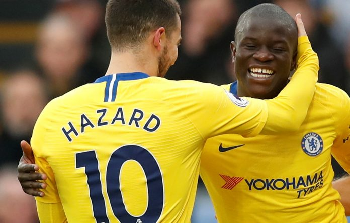 Chelsea's N'Golo Kante celebrates with Eden Hazard after scoring their first goal.