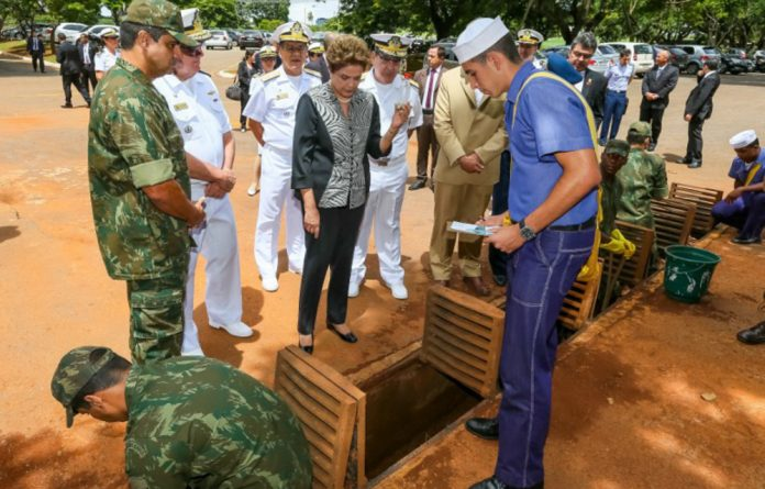 Brazil President Dilma Rousseff observes marines working in order to combat Aedes aegypti mosquitos in Brasilia.
