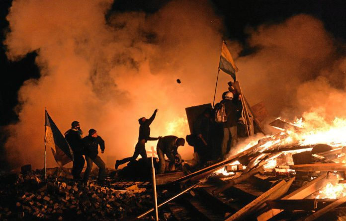 Anti-government protesters defy police amid the ruins of Kiev's Independence Square.