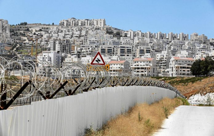 The wall between Israel and Palestine.